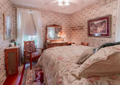 A comfortable full size bed and a private bath completes Emily's Room at Emily's BnB